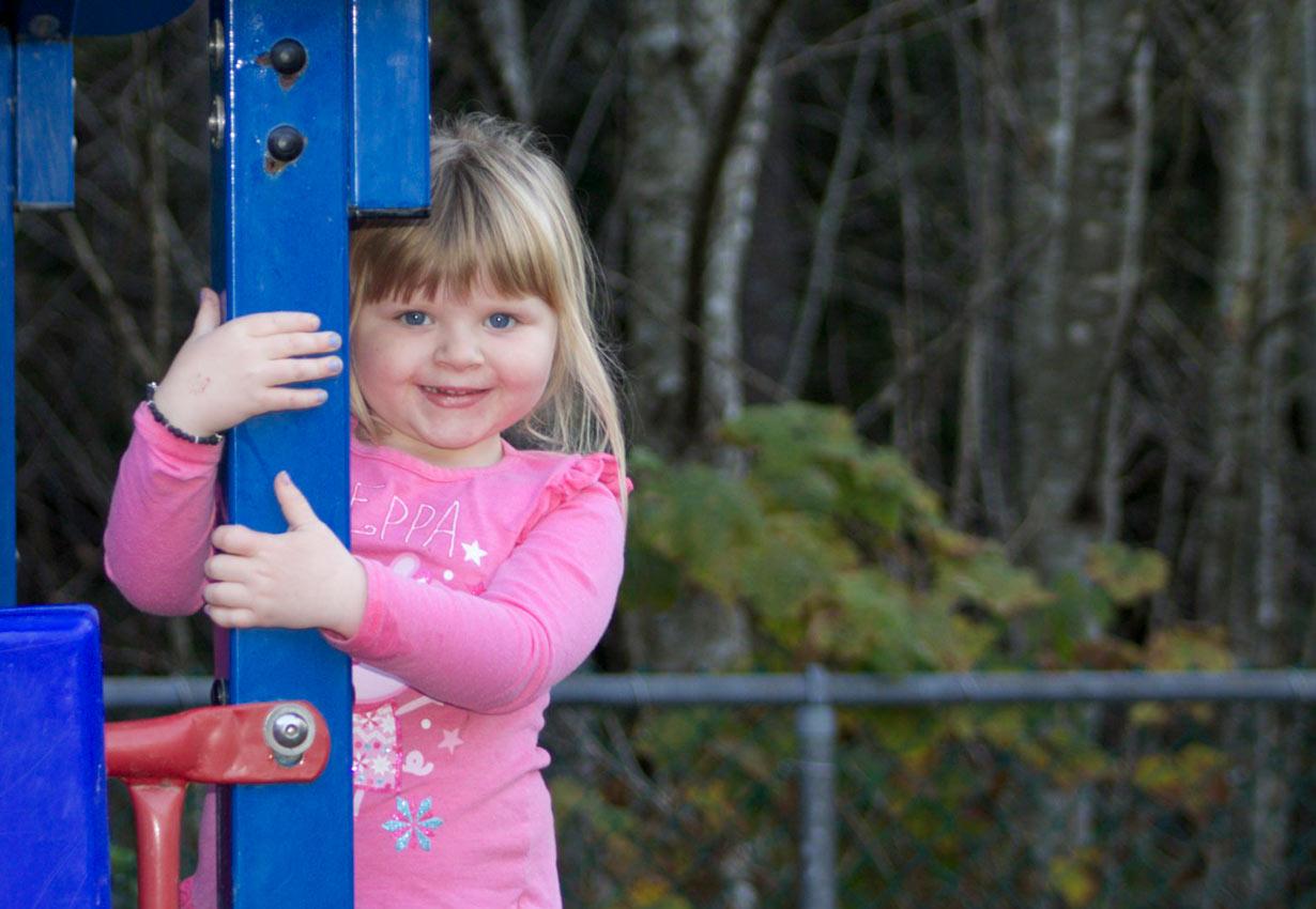 playing on playground equipment