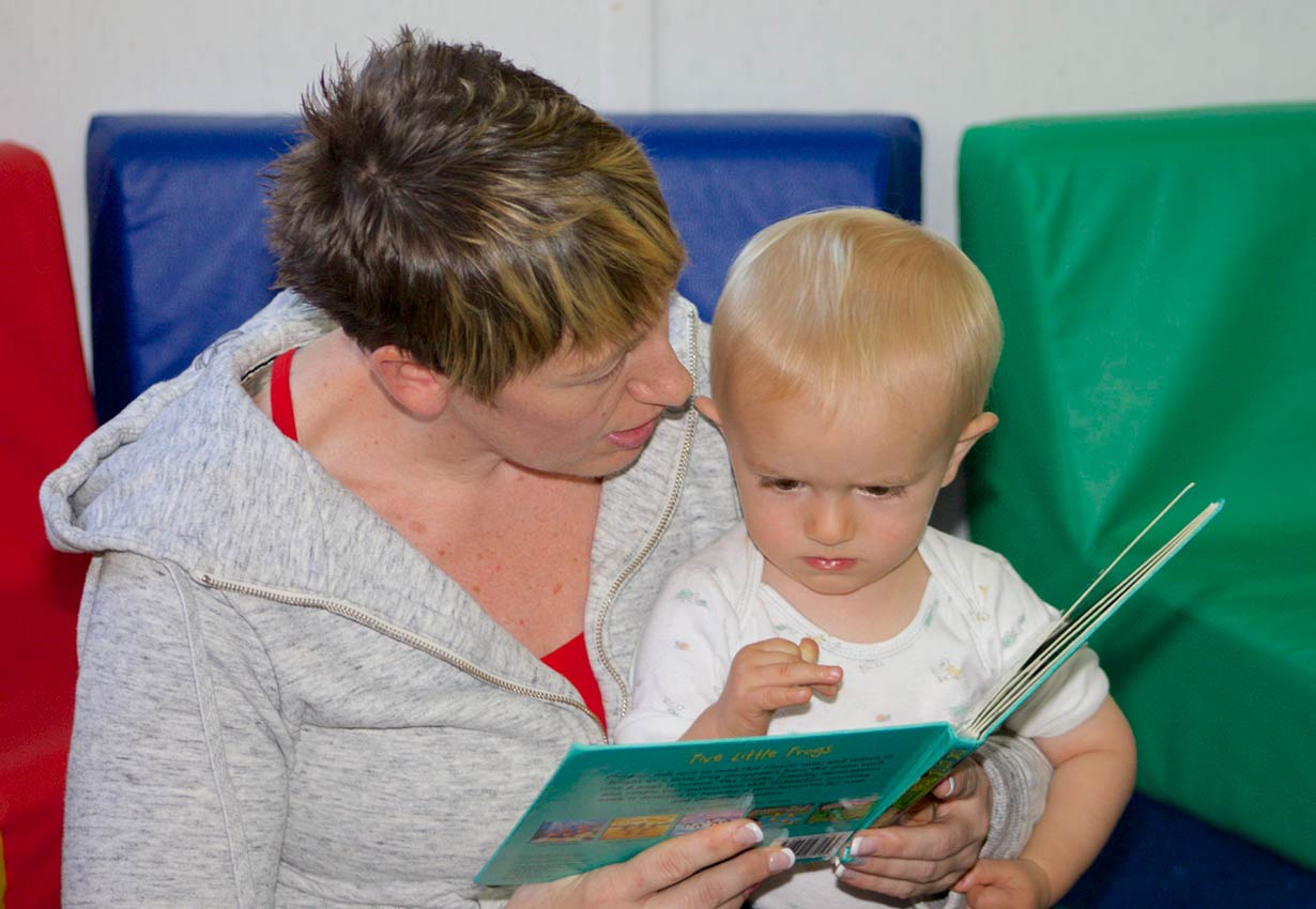 reading a book with a young child