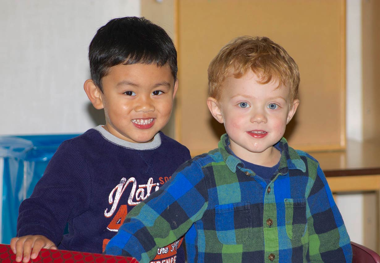 two happy young boys at child care